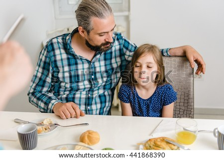 Father and Daughter having conversation during breakfast - stock photo