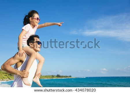 father and Daughter having fun on the beach - stock photo