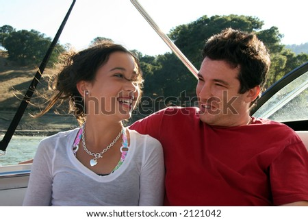 Father and daughter having good time boating - stock photo