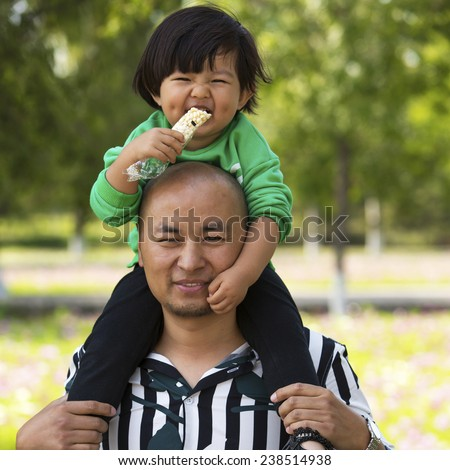 Father and daughter having playing in park outdoors.  - stock photo