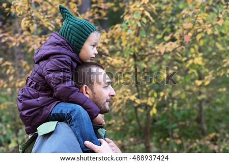 Father and daughter in an autumn forest