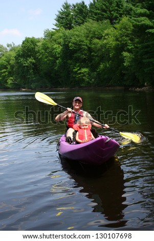 Father and daughter kayaking - stock photo