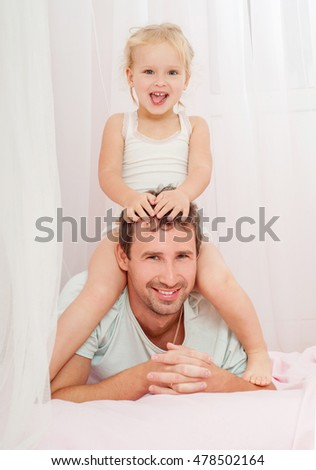 Father and daughter laughing and bonding