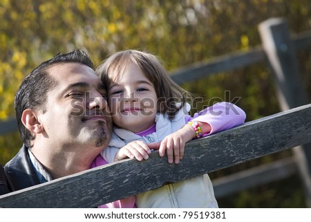 Father and daughter outdoor - stock photo