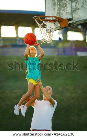 father and daughter playing basketball - stock photo