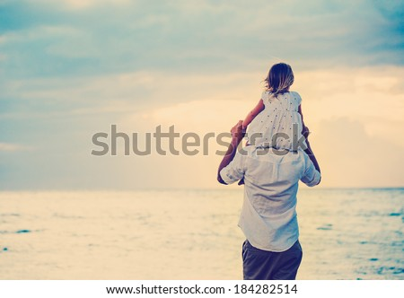 Father and Daughter Playing Together at the Beach at Sunset. Happy Fun Smiling Lifestyle - stock photo