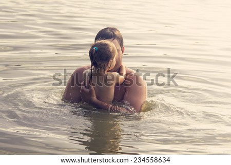Father and Daughter Playing Together at the sea at Sunset.  - stock photo
