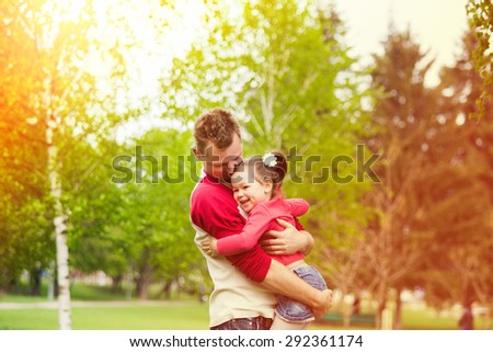 Father and daughter playing together in countryside. Happy family concept.  - stock photo