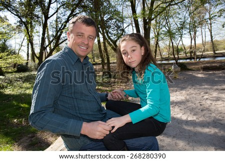 Father and daughter playing together outside - stock photo