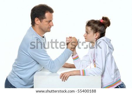 Father and daughter relations - wrestling in studio - two people on white background