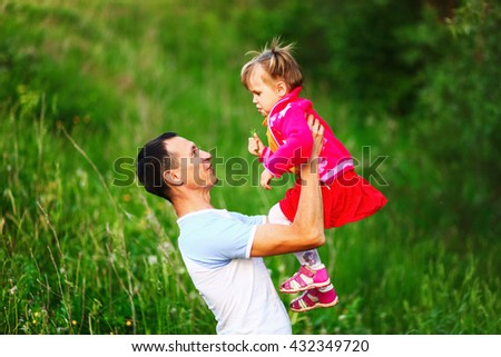 Father and daughter rest in park on nature. - stock photo