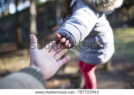 Father and daughter's hand holding hands