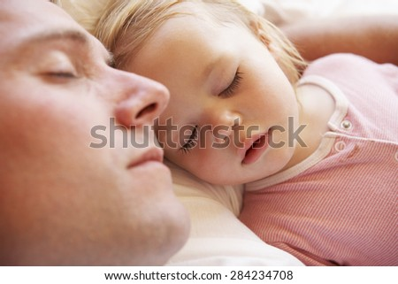 Father And Daughter Sleeping In Bed - stock photo