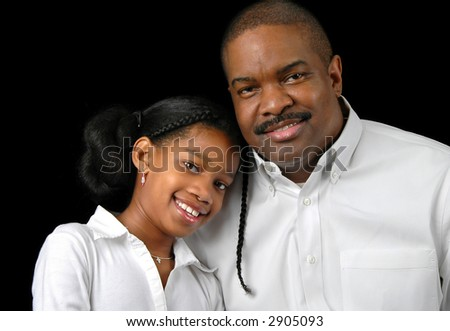 Father and daughter smiling over a black background