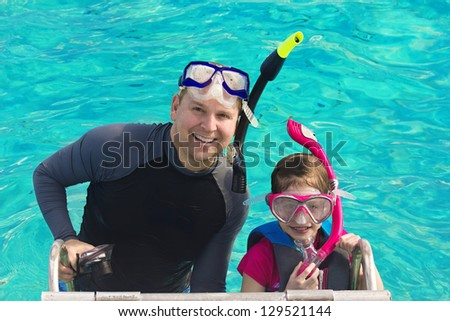 Father and Daughter Snorkeling in the Caribbean - stock photo