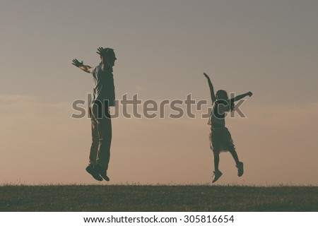 Father and daughter spending time together outdoor.Precious family moments Image is intentionally with grain and toned. - stock photo