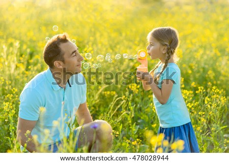 Father and daughter spending time together outdoors