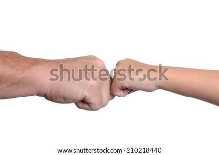 father and daughter tapping knuckles isolated white background - stock photo