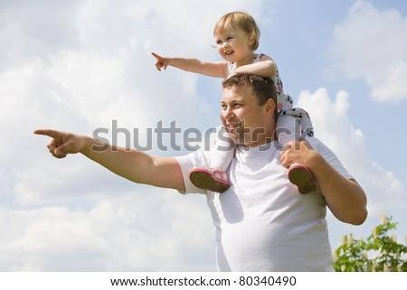 father and daughter under blue sky