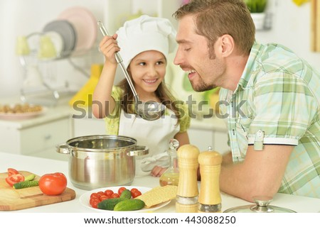 father and daughter with food - stock photo
