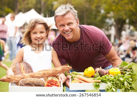 Father And Daughter With Produce From Outdoor Farmers Market - stock photo