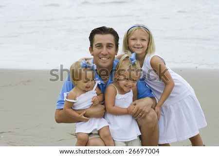 Father and Daughters - stock photo