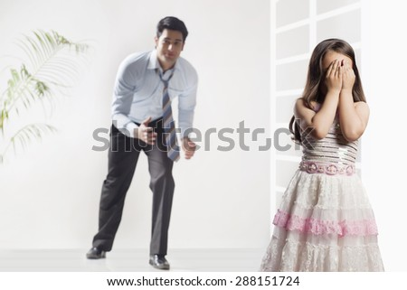 Father and girl playing hide and seek game