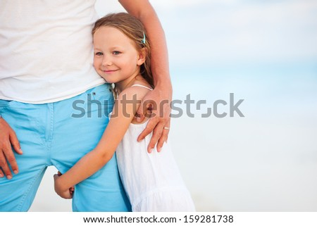 Father and his adorable little daughter at tropical beach - stock photo