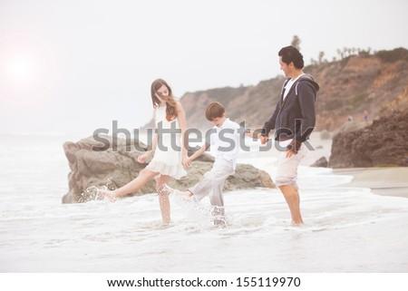 Father and his children at the beach in Malibu California - stock photo