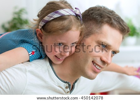 Father and his daughter playing at home. - stock photo