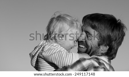 Father and his daughter share a happy moment in the setting sun.   - stock photo