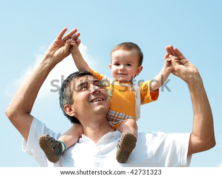 Father and his little son are playing outdoor