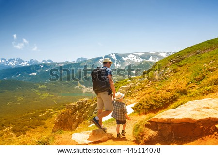 Father and his little son near the Seven lakes in Rila mountain, Bulgaria