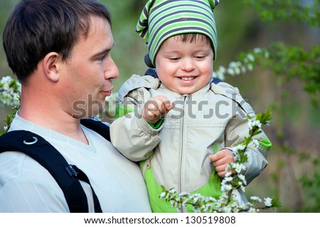 Father and his little son talking outdoors - stock photo