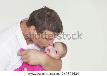 Father and His Newborn Child Together. Indoors shot. Horizontal Image - stock photo