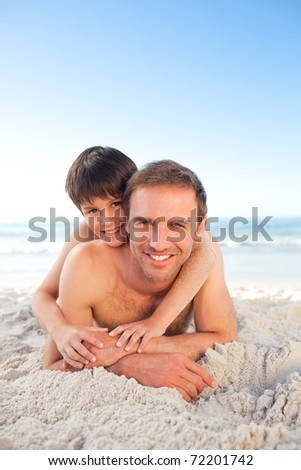 Father and his son at the beach