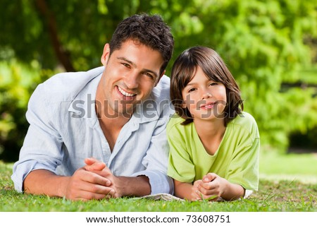 Father and his son lying down - stock photo
