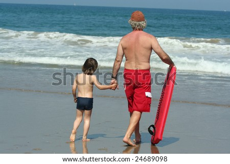 father and his son on the beach