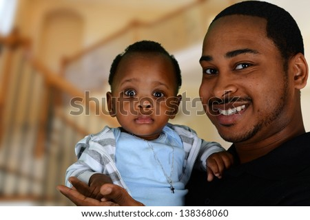 Father and his son playing inside their home - stock photo