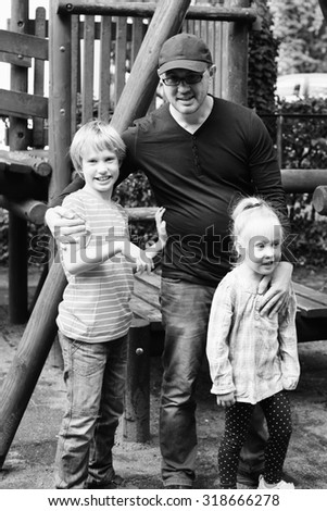 Father and kids playing on the playground  - stock photo