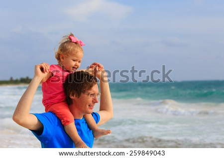 father and little daughter on summer beach vacation