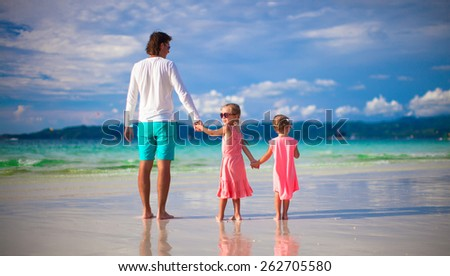 Father and little girls together during tropical vacation - stock photo