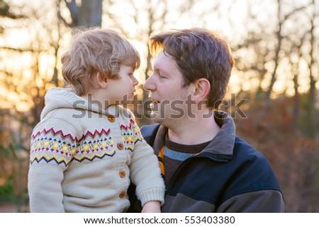 shy boy having shoe kissed