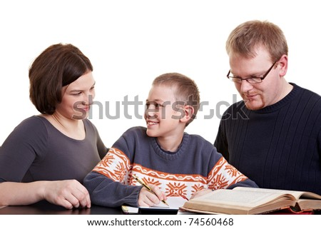 Father and mother helping son who is doing his homework - stock photo
