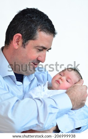 Father and newborn baby kissing and hugging. concept photo happy family, motherhood, newborn, baby, lifestyle.