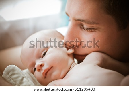 Father and  newborn son near the window / Fatherly love