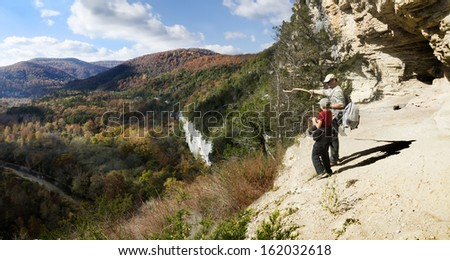 Father and son admiring the autumn scenery. Buffalo River, Arkansas, United States - stock photo