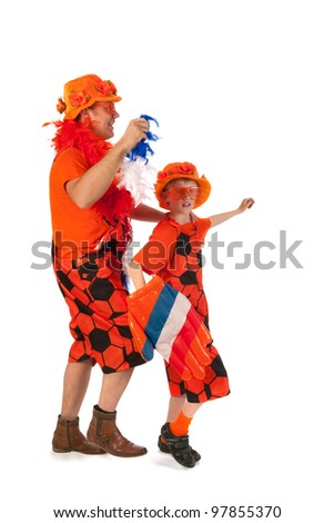 Father and son as Dutch orange soccer fans - stock photo