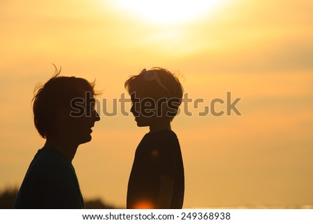 father and son at sunset beach, family concept - stock photo