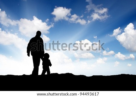 Father and son. Bright sunshine and silhouettes